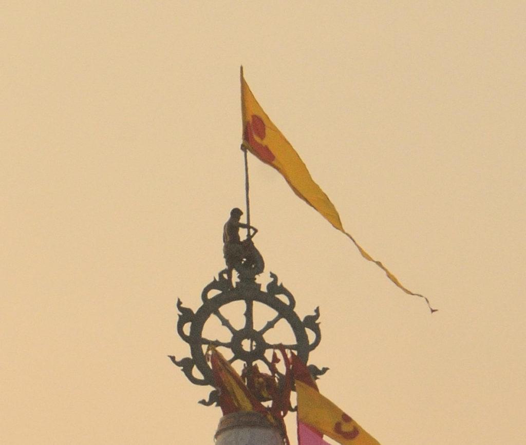 The daily flag changing ritual atop Lord Jagannath temple, Puri, Odisha