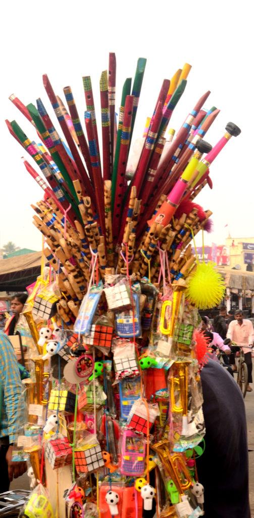 A flute seller at market near Lord Jagannath temple, Puri , Odisha.