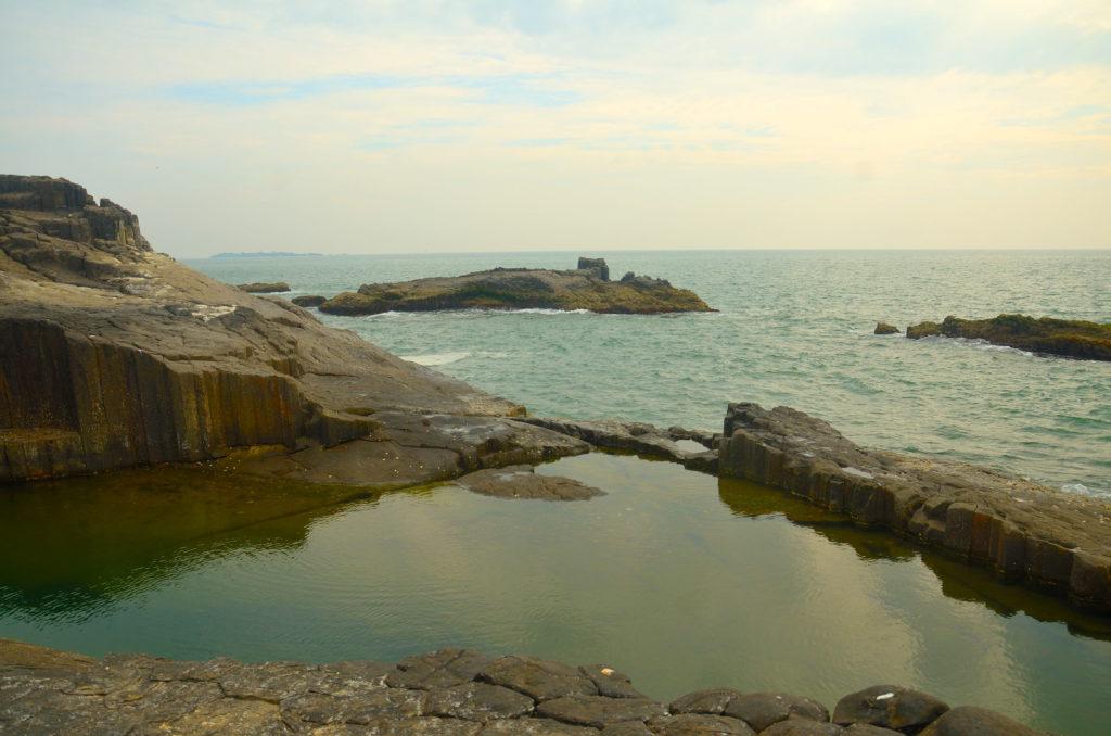Small pools are made by sea water at St. Marry Island, near Malpe, Karnataka, India.